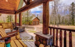 Log Home By Golden Eagle Log and Timber Homes - front entry covered porch view 3