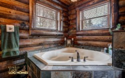 Log Home By Golden Eagle Log and Timber Homes - master bathroom view 2