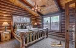 Log Home By Golden Eagle Log and Timber Homes - master bedroom