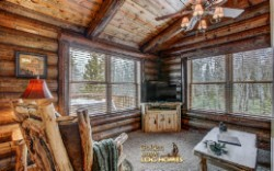 Log Home By Golden Eagle Log and Timber Homes - sitting area