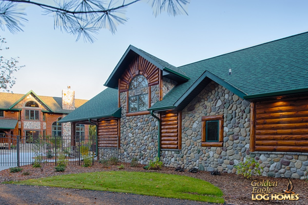 Side exterior view for Log and stone homes